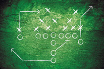 Football play drawn on green board