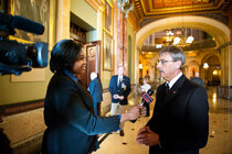 A reporting intern conducts an interview inside the Illinois Capitol.