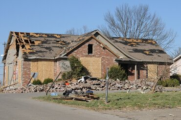 Damage to a home in Harrisburg, Ill., from a tornado in 2012