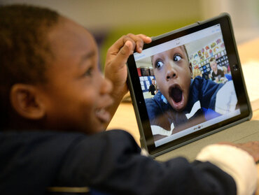 Second grader takes self-portrait with iPad