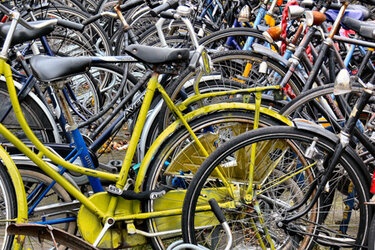 Colorful bicycles in a rack