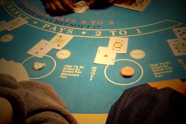 Two people at a blackjack table
