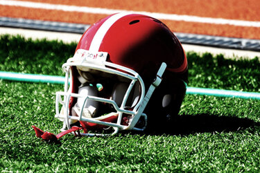 Football helmet on turf