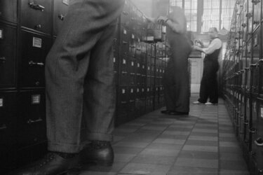 Federal government office workers searching files in Washington, D.C., 1939.