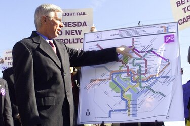 Parris Glendening gestures at a map of the prospective Purple Line