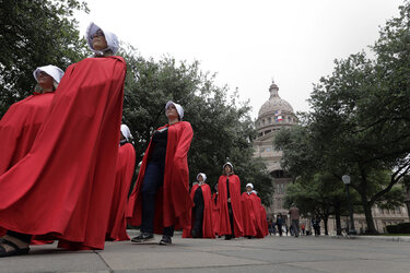 """Activists dressed as characters from """"The Handmaid's Tale"""" outside the Texas Capitol."""