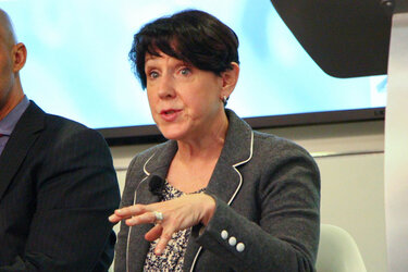 Debbie Walsh speaking at an event.