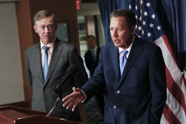 Ohio Gov. John Kasich and Colorado Gov. John Hickenlooper at a press conference.