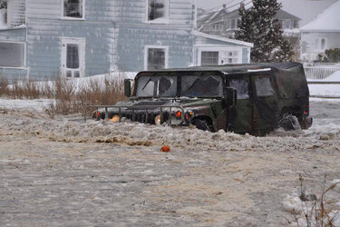 The Massachusetts National Guard assists a local fire department during a winter storm in January.