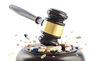A gavel hitting pills.