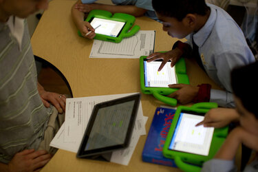 Students use tablets in school.