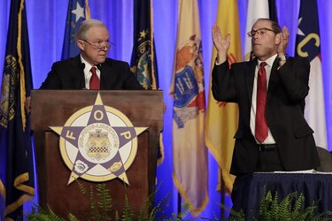 Attorney General Jeff Sessions being applauded by Fraternal Order of Police National President Chuck Canterbury
