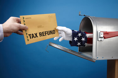Uncle Sam giving tax refund through the mail.