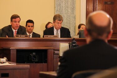 Sens. Mark Warner, left, and Roy Blunt, right, question witnesses during a Surface Transportation and Merchant Marine Infrastructure, Safety and Security subcommittee hearing.