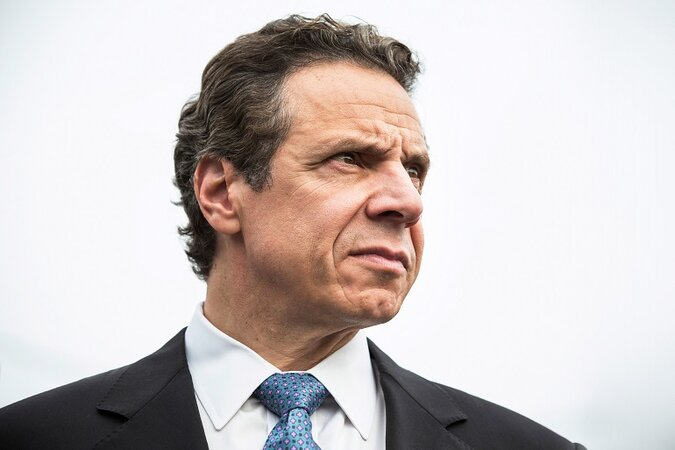 Andrew Cuomo stares off into the distance