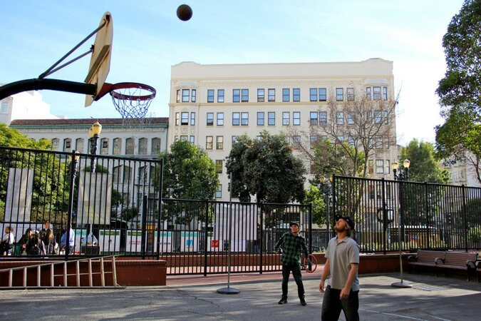 Men playing basketball at San Francisco's Boeddeker Park