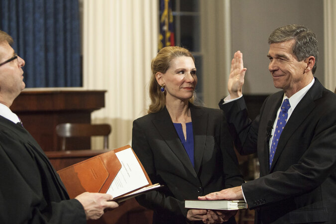Roy Cooper being sworn in as North Carolina governor.