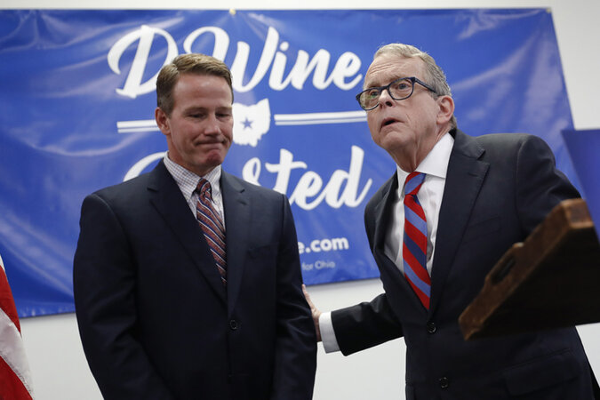 Mike DeWine and Jon Husted at a news conference.