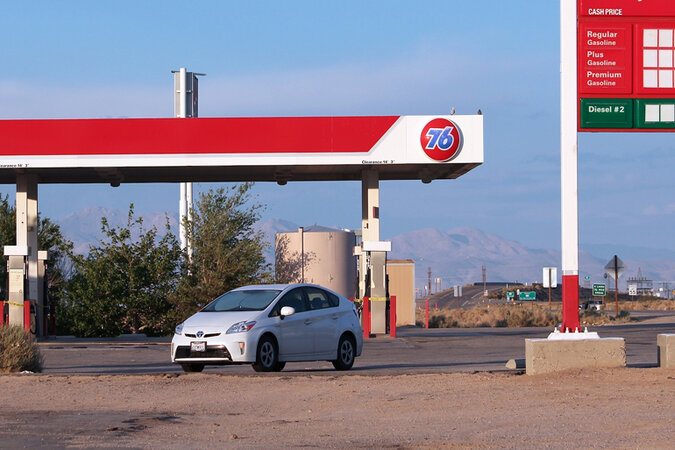 Prius parked at a gas station in California.