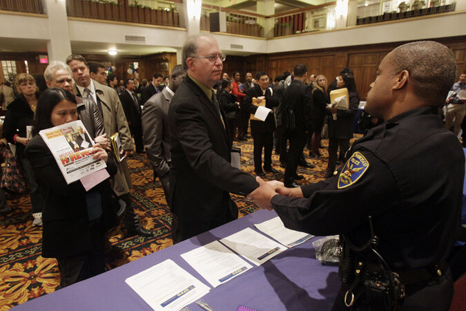 Job seekers lined up at a job fair.