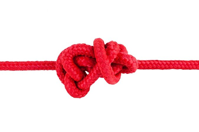 Red rope tied in a knot.