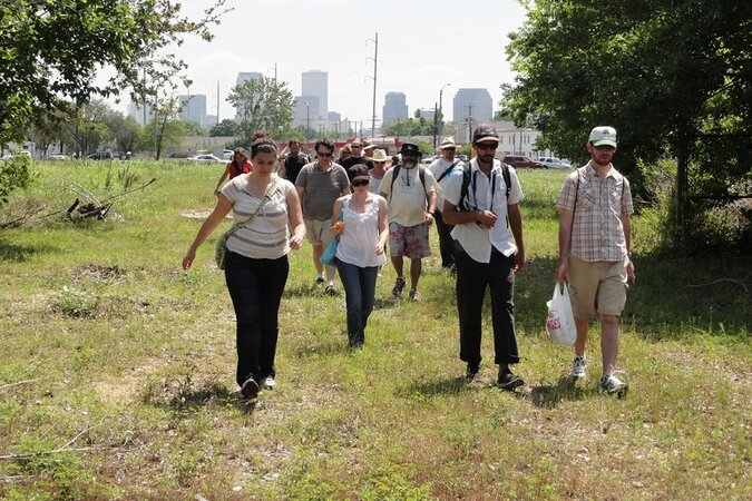 People walking on the Lafitte Greenway in New Orleans.