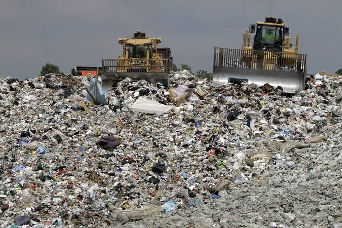 Trucks in a landfill