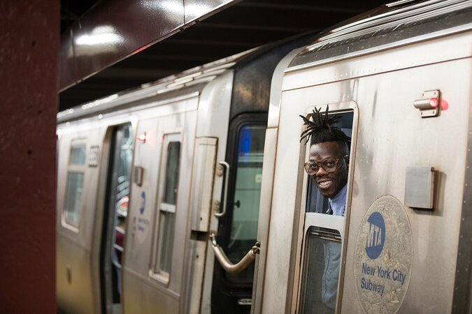 NYC subway conductor looking out the window.