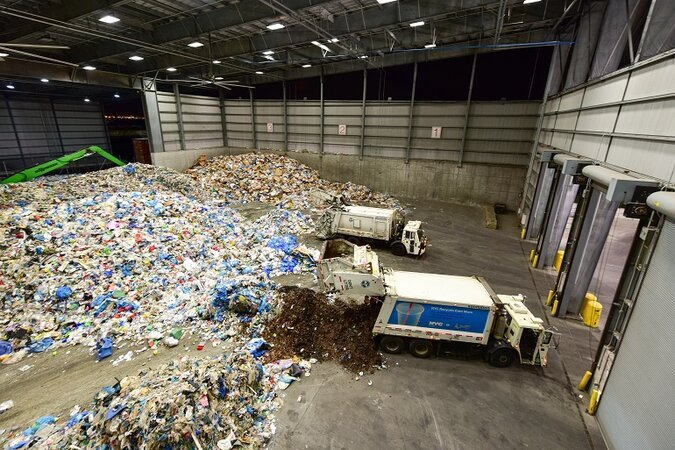 A recycling center with trucks.