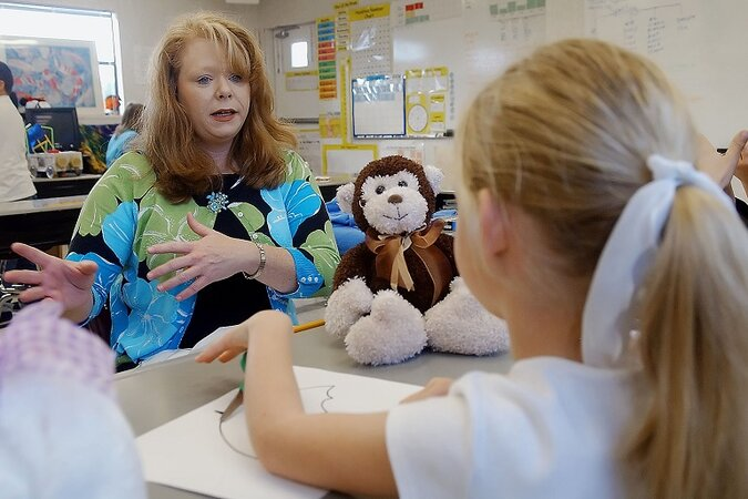 School counselor talks to student