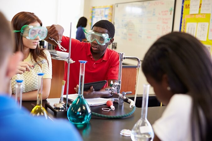 Students doing an experiment in a science classroom.