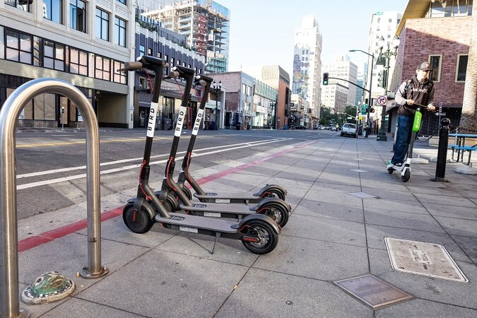 Electric scooters on a sidewalk.
