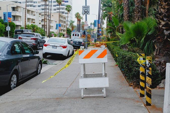 Sidewalk in Los Angeles with construction sign.