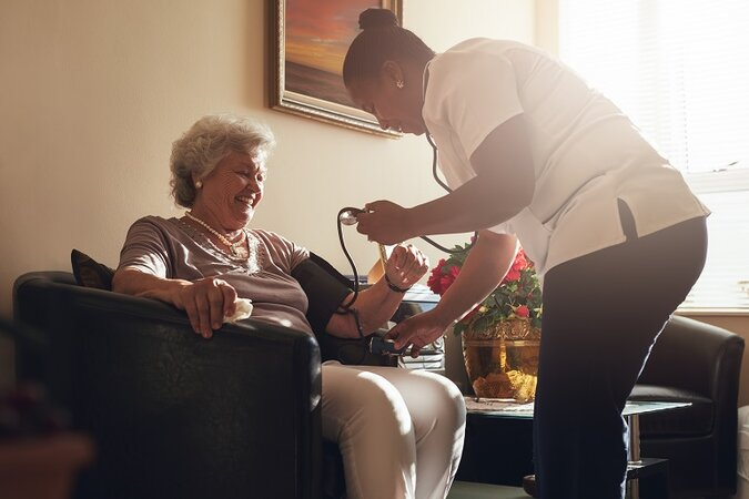 elderly woman gets a check-up in her home