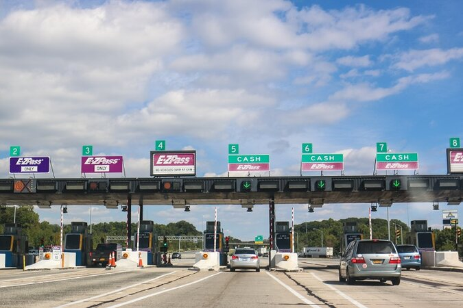 Cars going through the EZ-pass lanes in a toll.