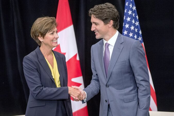 Canadian Prime Minister Justin Trudeau, right, meets with Iowa Gov. Kim Reynolds at the National Governors Association's annual summer meeting.