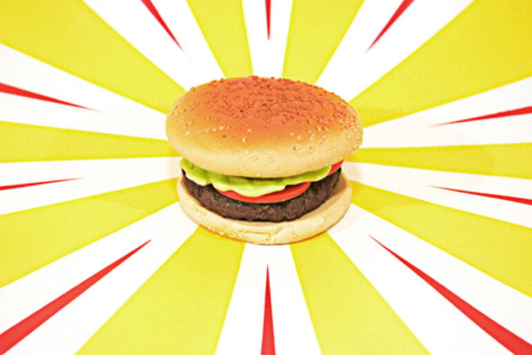 Plastic burger with colorful background
