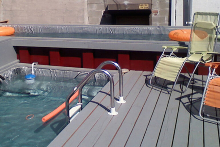 Dumpster pool with chairs