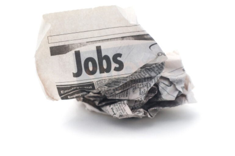 Crumpled Jobs section of newspaper