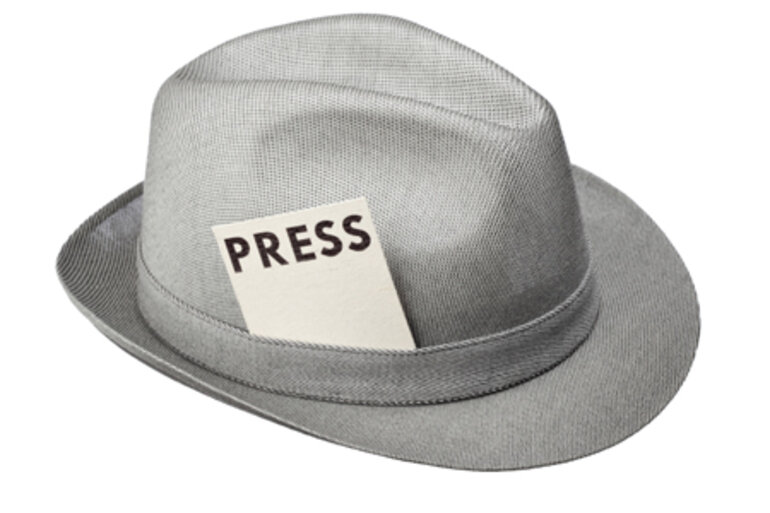 "Hat with card reading ""press"""