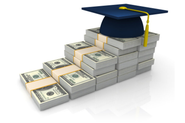 Graduation cap sitting atop staggered money