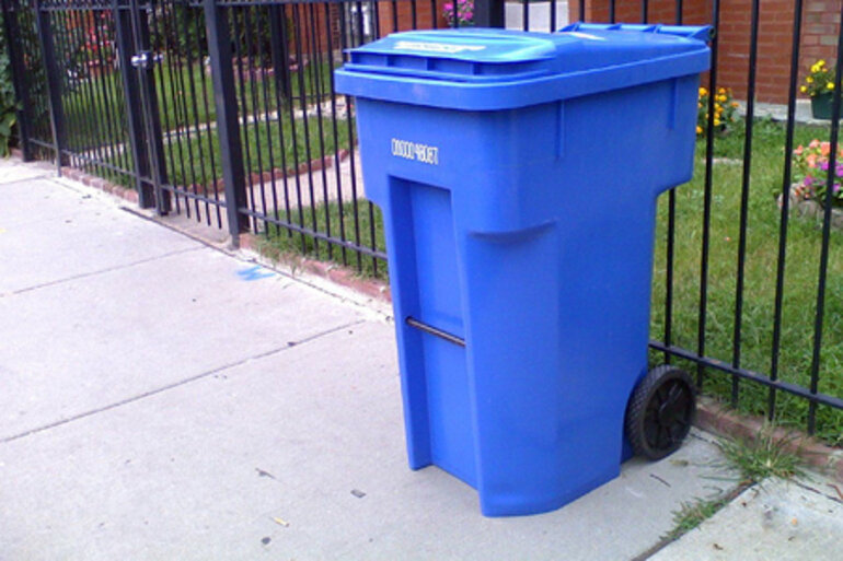 Recycling cart outside a home