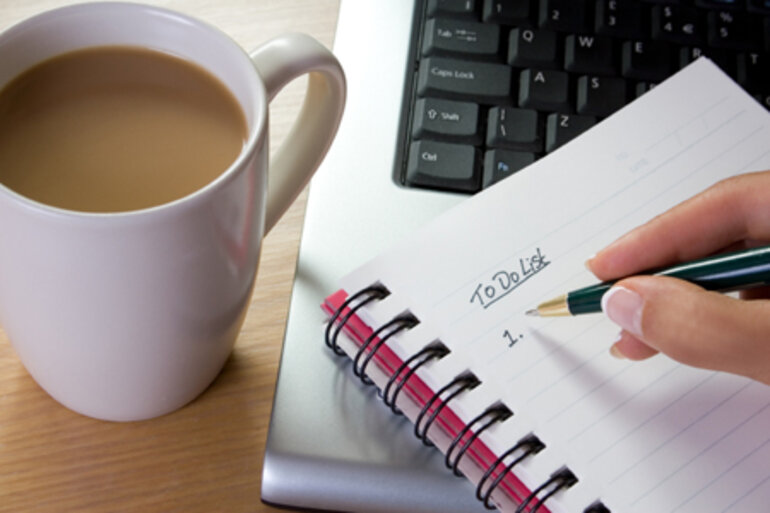 Coffee cup, laptop and to-do list