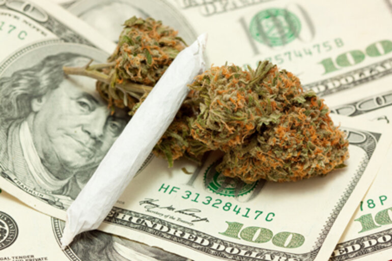 Shot of marijuana bud, joint and money