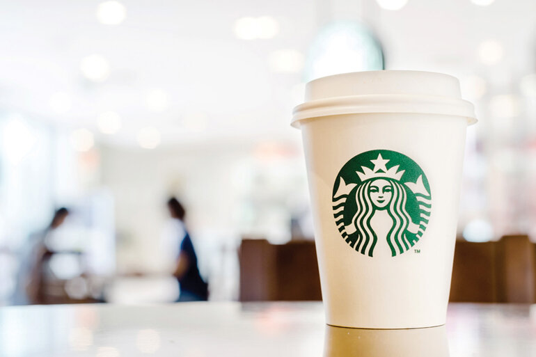 Image of a Starbucks cup in a coffee shop