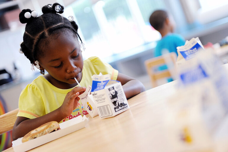 Children who qualify for free or reduced-cost meals as part of federal programs to feed low-income youth during the summer eat breakfast at the Deanwood Recreation Center in Washington, D.C.