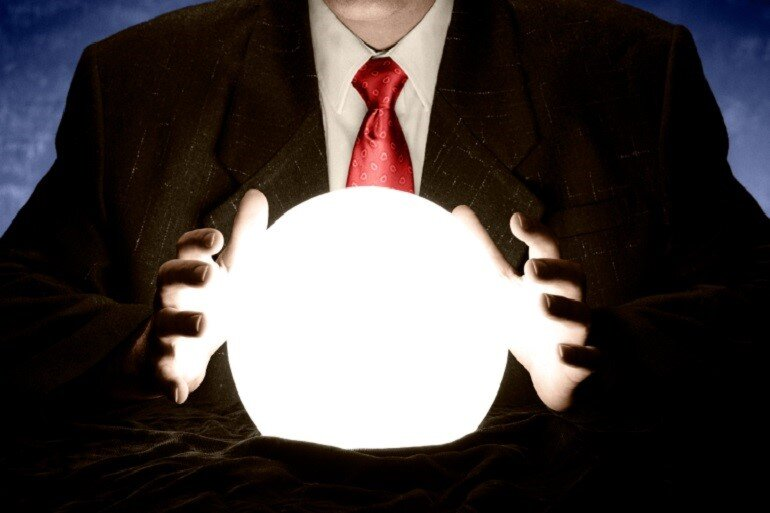 Businessman consulting a crystal ball.
