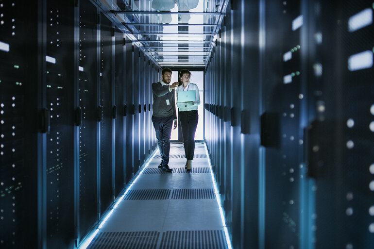 People walking through a data center.