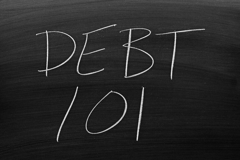 "Chalkboard with ""DEBT 101"" written on it."