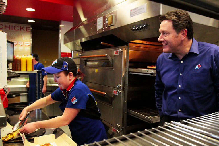Domino's Pizza CEO Patrick Doyle oversees operations in one of the pizza chain's locations.